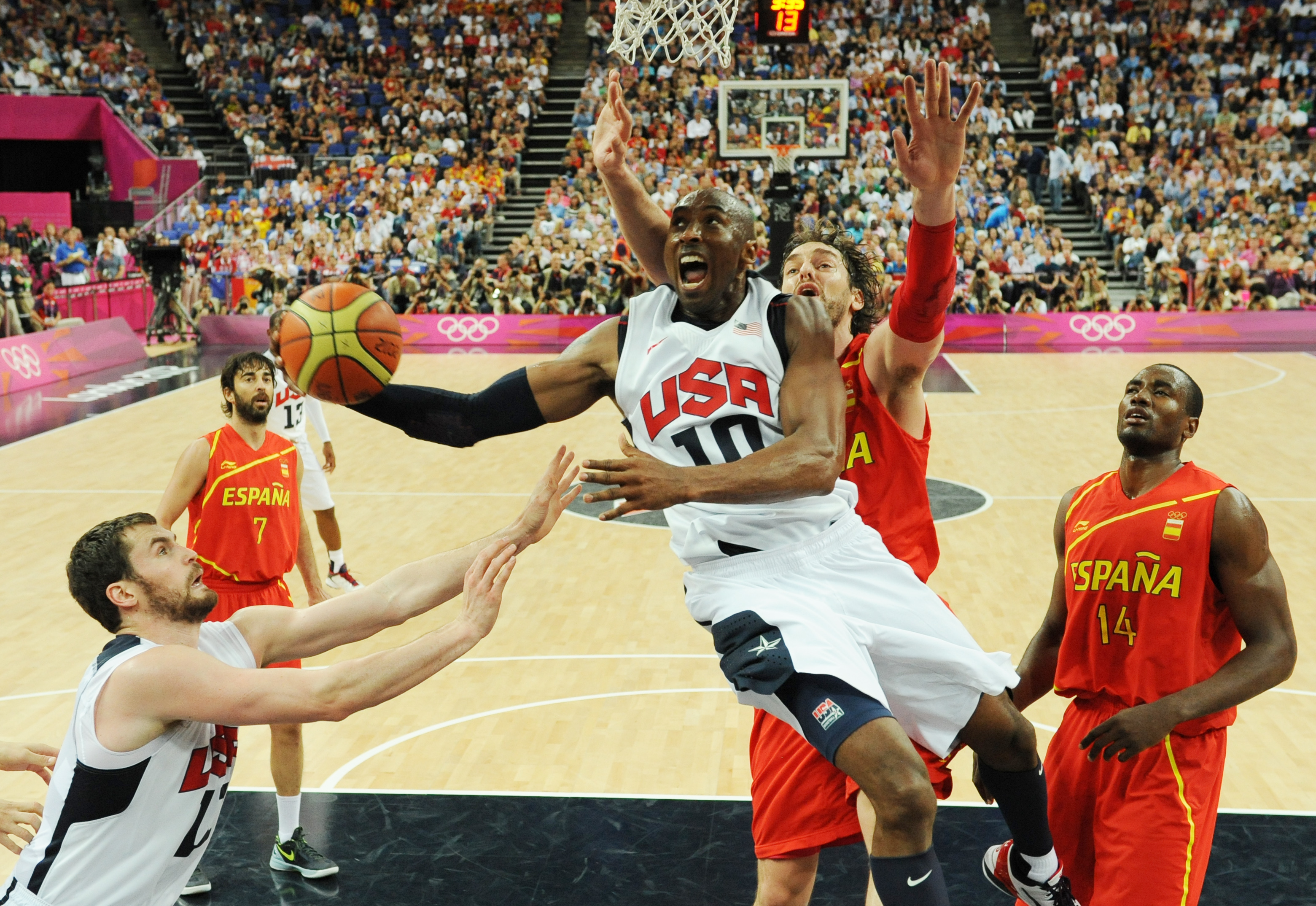 (FILES) In this file photo taken August 12, 2012 US guard Kobe Bryant jumps to score during the London 2012 Olympic Games men's gold medal basketball game between USA and Spain at the North Greenwich Arena in London. Kobe Bryant says he still loves competition, but admits that his body can no longer handle the rigors of professional basketball as he announced on November 29, 2015 that this will be his final NBA season. AFP PHOTO / MARK RALSTON / AFP / POOL / MARK RALSTON